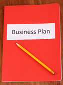 Red folder labeled business — Stock Photo