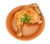 Roasted chicken leg with parsley in the plate isolated on white — Stock Photo