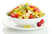 Bowl with fresh fruits salad and berries isolated on white — Stock Photo