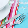 Table setting with fork, knife, plates, and napkin — Stock Photo #11175753
