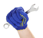 Wrench in hand with protection glove isolated on white — Stock Photo