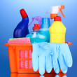 Basket with cleaning items on blue background — Stock Photo #11194641