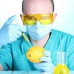 Scientist injecting GMO into the lemon — Stock Photo