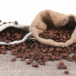 Stock Photo: Coffee beans in canvas sack isolated on white