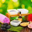Cosmetic clay for spa treatments isolated on colorful green background — Stock Photo
