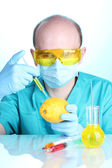 Scientist injecting GMO into the lemon — Stock Photo
