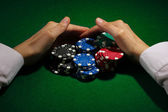 Taking win in poker on green table — Stockfoto