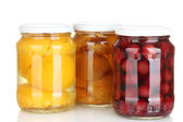 Jars of canned fruits isolated on white — Stock Photo