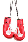 Red boxing gloves hanging isolated on white — Stockfoto