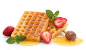 Belgium waffles with honey, strawberries and mint isolated on white — Stock Photo