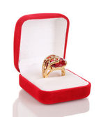 Gold ring with big red gem and clear crystals in red velvet box isolated on white — Стоковое фото