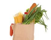 Bolsa de papel con alimentos aislados en blanco — Foto de Stock