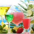 Glasses of cocktails on table on blue sky background — Stock Photo