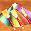 Paint brushes and bright palette of colors on wooden background - 图库照片