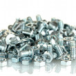 Chrome nuts and bolts on white background close-up - 图库照片
