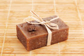 Hand-made soap on wooden mat — Stock Photo