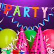 Stock Photo: Party items on purple background
