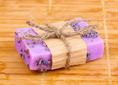 Hand-made lavender soap on wooden mat — Stock Photo