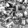 Chrome nuts and bolts close-up - Stock Photo
