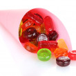 Tasty colorful candies in bright bag isolated on white — Stock Photo