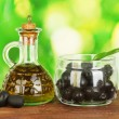 Olive oil small decanter on green background close-up — Stock Photo