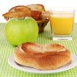 Classical breakfast. Orange juice and bun — Stock Photo #11318500