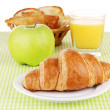Classical breakfast. Orange juice and croissant — Stock Photo #11318506