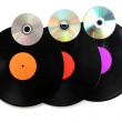 Black vinyl records and CD disks isolated on white — Stock Photo