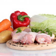 Fresh vegetables with raw chicken drumsticks and pork steak on cutting board isolated on white — Stock Photo #11319210