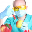 Scientist injecting GMO into the apple - Stock Photo