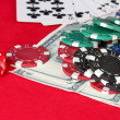 The red poker table with playing cards, poker chips and dollars — Stock Photo