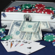 Suitcase with dollars on the blue poker table — Stock Photo