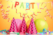 Party items on orange background — Stock Photo