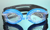 Blue swim goggles with drops on blue background — Stock Photo