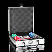 Poker set in metallic case isolated on black background — Stock Photo