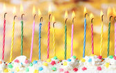 Beautiful birthday candles on yellow background — Stock Photo