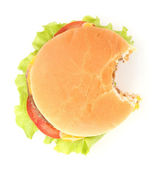 Bitten cheeseburger isolated on white — Stock Photo