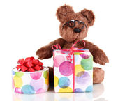 Sitting bear toy with gifts isolated on white — Stock Photo
