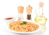Composition of the delicious spaghetti with tomato sauce isolated on white — Stock Photo