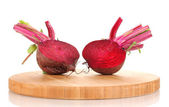 Young red beet on wooden board isolated on white — Stock Photo