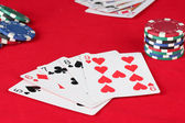 The red poker table with playing cards. The combination of straight — Stock Photo
