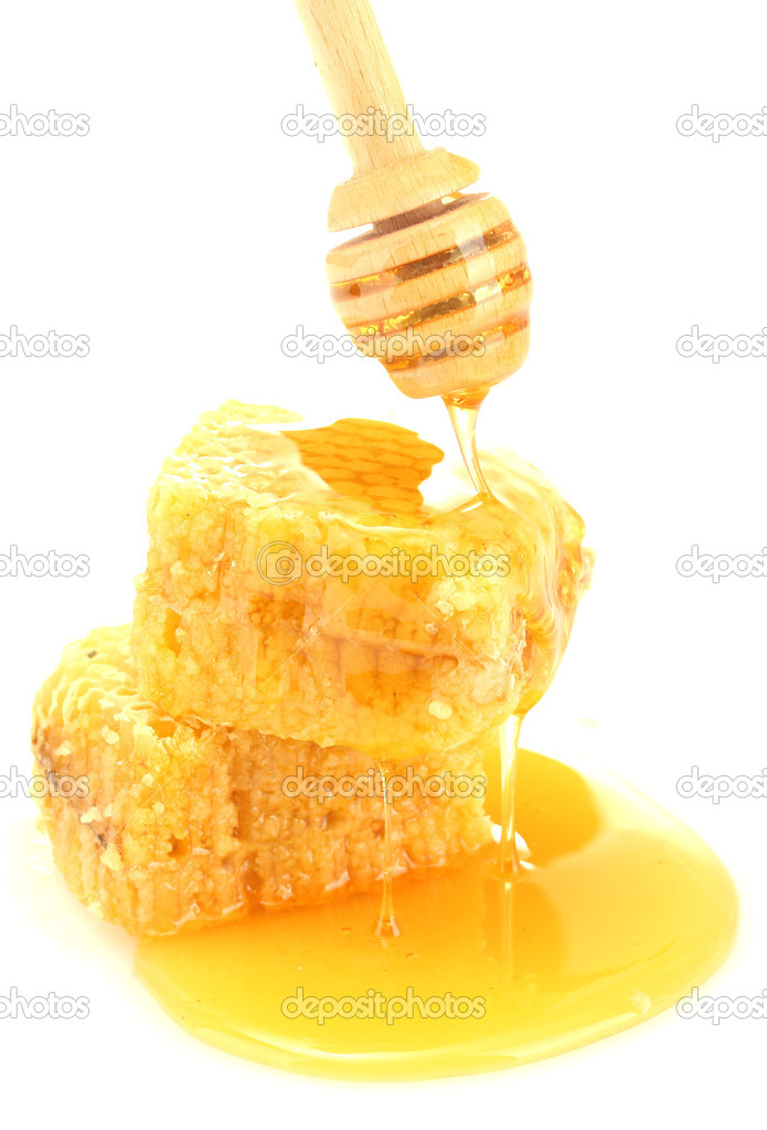 Golden honeycombs and wooden drizzler with honey isolated on white  Stock Photo #11315060