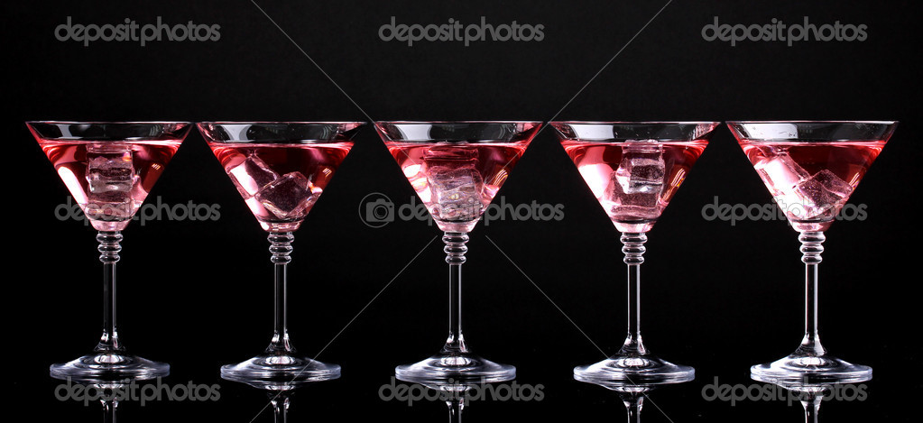 Red cocktail in martini glasses isolated on black — Stock Photo #11318947