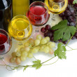 Bottles and glasses of wine and ripe grapes isolated on white — Stock Photo #11320190