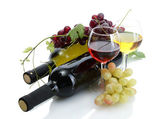 Bottles and glasses of wine and ripe grapes isolated on white — Stock Photo