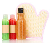 Bottles with scrub and sponge isolated on white — Stock Photo