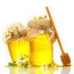 Sweet honey jars and acacia flowers isolated on white — Stock Photo