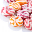 Striped fruit candies isolated on white - Photo