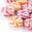Striped fruit candies isolated on white - 