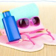 Beach accessories on mat — Stock Photo #11352578